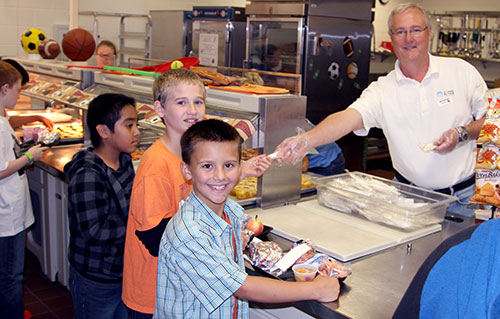Joe Pickens hands out lunches to students