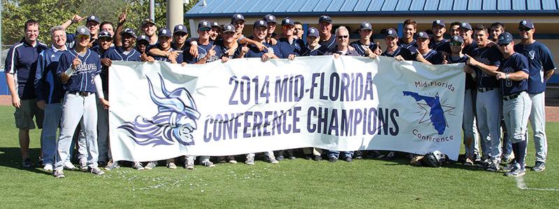 Baseball team holding MFC Championship banner