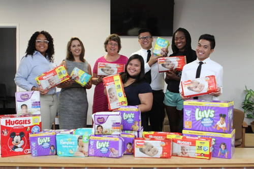 students collect diapers