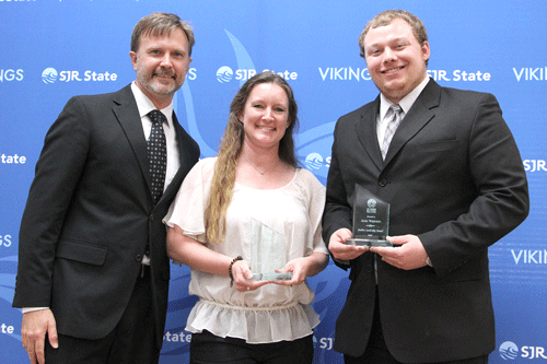 Mary Steele and Alex Wescott recieve leadership award from Stephen Tomasovitch
