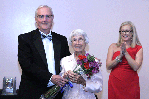 President Joe Pickens and Vice President for Development Caroline Tingle (background) present special guest Evelyn Hewett, 89, with flowers