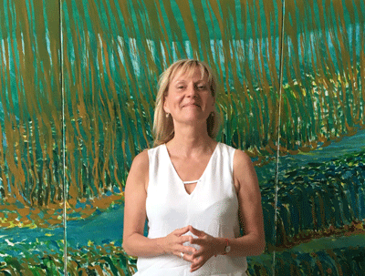"Artist Beate Renner and her painting ""The Hanging Gardens of Babylon"""