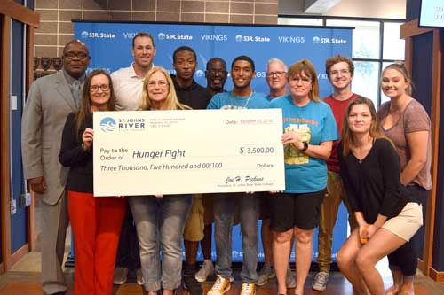 St. Johns River State College presented a check for $3,500 to Hunger Fight for supplies for the event