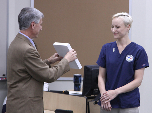 Flagler Hospital's Director of Radiology Larry Smith presented the Daniel Maj Scholarship to Egle Donaghue