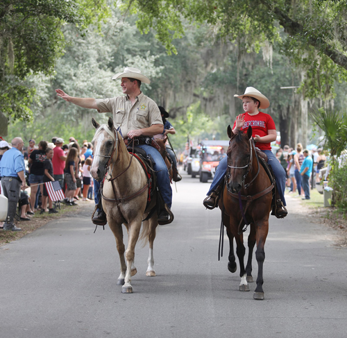 Sheriff DeLoach riding horse in parade