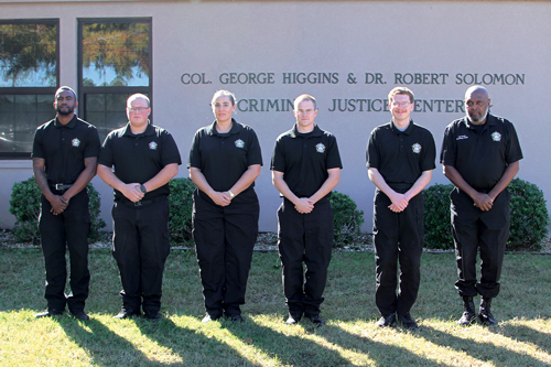 corrections cadets A. Ward, T. Van Dyke, L. Welty, S. Ficke, C. Courtney, and  	Calvester Davis (Instructor/Coordinator)