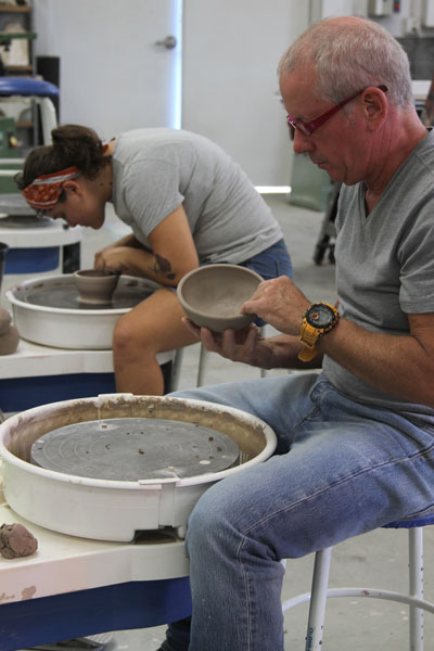 Florida School of the Arts alumna Lydia Borko and faculty sponsor Dan Askew create bowls for the annual Empty Bowls project scheduled for Friday, October 18, from 5:30 – 8:00 p.m., at Beef 'O' Brady's