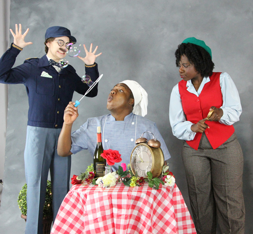 """FloArts students Dana Cox, Malik Johnson and Facia Lee practice for """"The Man Who Killed Time."""""""