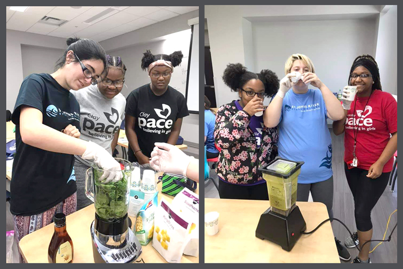 Girls making and trying green smoothies