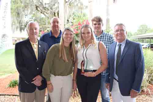SJR State President Joe Pickens, Athletic Director and Head Baseball Coach Ross Jones, Head Softball Coach Marti Littlefield, Brooklynn Basile, Darin Kilfoyl and Assistant Athletic Director John R. Theobold.