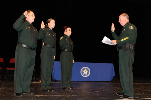 SJR State Law Enforcement Academy cadets, from left to right, Anthony Cuthbert and Kathryn Gordon from Flagler County, and Allyssa Narciso from St. Johns County were sworn in to the Flagler County Sheriff's Office by Sheriff Rick Staly