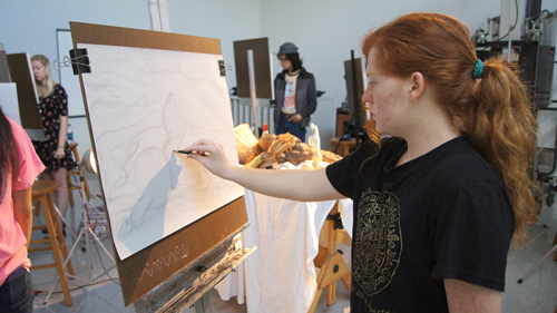 visual arts major Kyla Hardy concentrating on her drawing assignment in the art studio