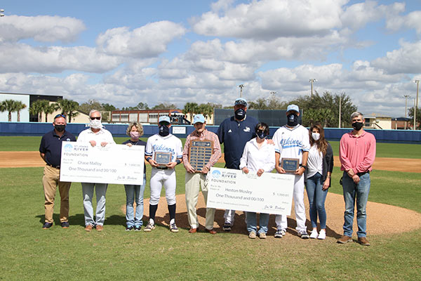 scholarship recipients, players, coaches, family group photo